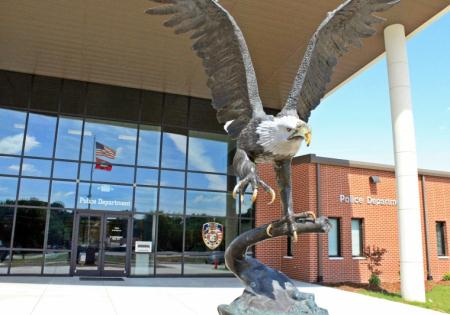 Police Department Behind an Eagle Statue